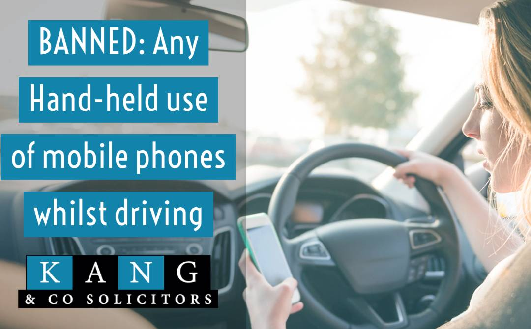 Ban on any use of hand-held mobile phones whilst driving